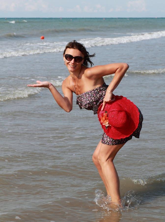 Woman presenting new product at sea royalty free stock photo