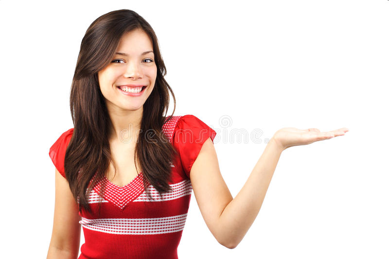 Woman presenting with open hand stock photo