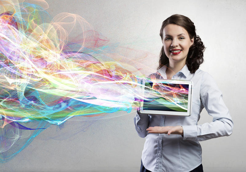 Woman presenting tablet pc royalty free stock image