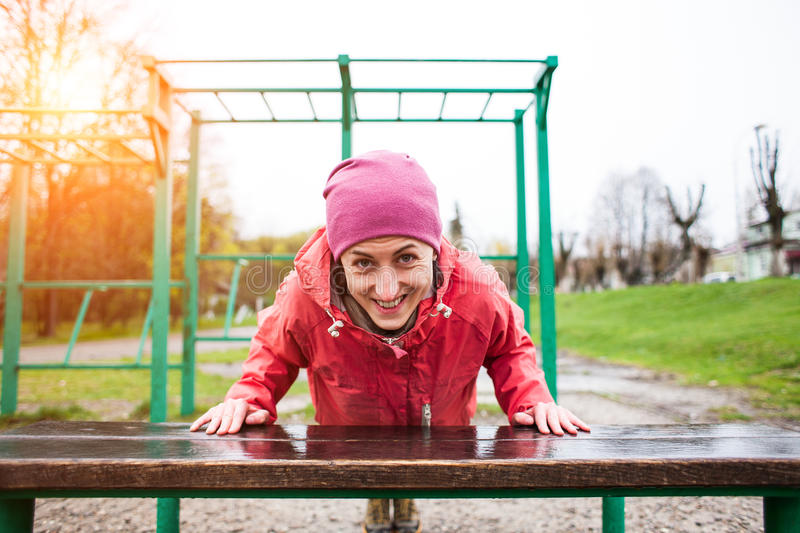 The woman pressed from the bench. stock photo