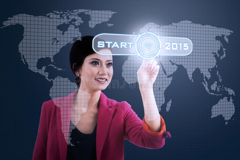 Woman pressing business start button stock photography