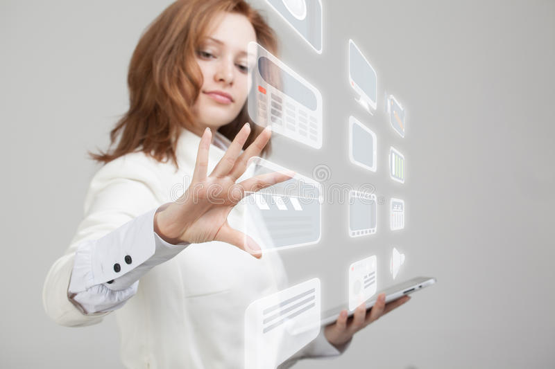 Woman pressing high tech type of modern multimedia. Young businesswoman pressing high tech type of modern multimedia buttons on a virtual background royalty free stock photography