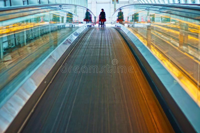Woman pressing the moving walkways and stroller. Shooting location : Kamakura, Kanagawa Prefecture royalty free stock images