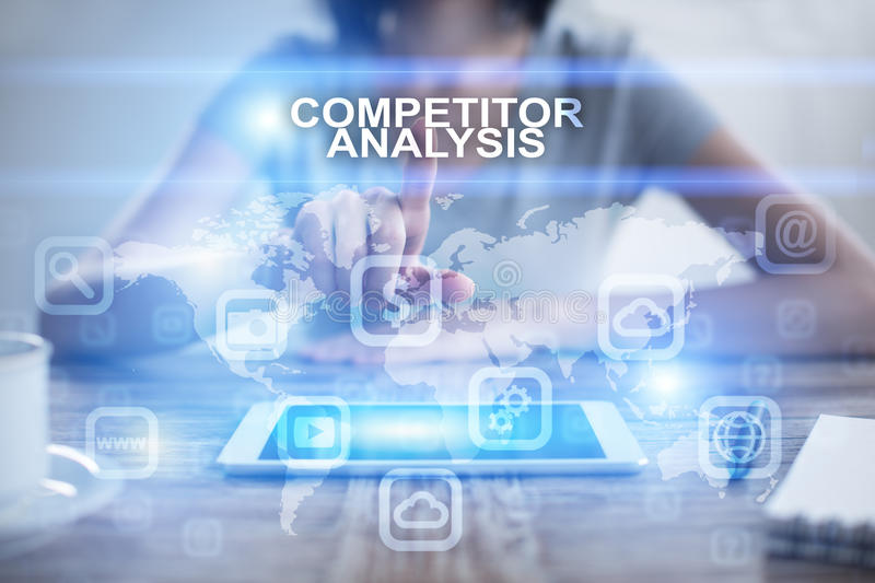 Woman pressing on virtual screen and selecting competitor analysis. Woman using tablet pc, pressing on virtual screen and selecting competitor analysis royalty free stock photo