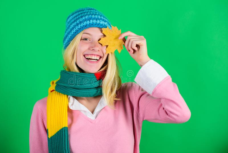 Woman pretty cute smiling face wear knitted hat hold fallen leaves. Time to rejuvenate and repair skin. How to update stock photo