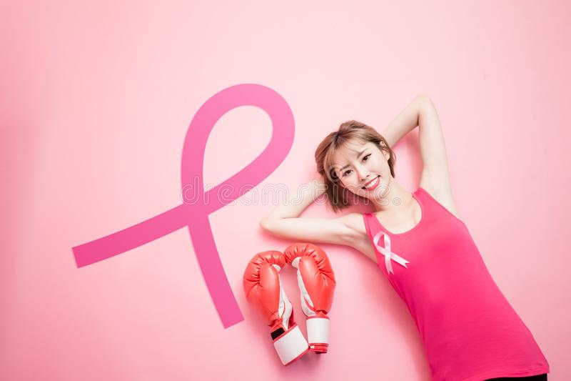 Woman with prevention breast cancer. Woman lying on floor with prevention breast cancer concept royalty free stock photos