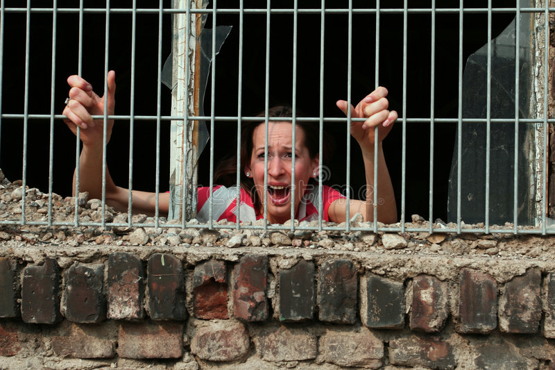 Woman in prison stock photo