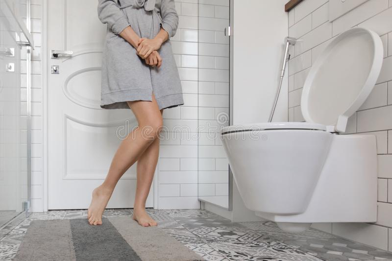 Woman problem holding her hands in toilet stock image