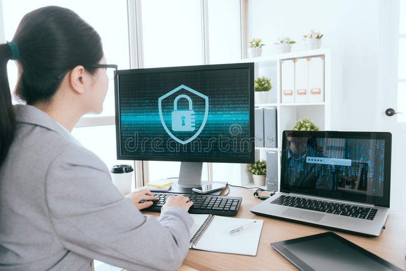 Woman processed online information security. Professional business woman is working and using keyboard typing processed company online information security royalty free stock photo