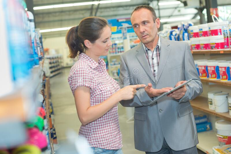 Woman and product information representative stock photography