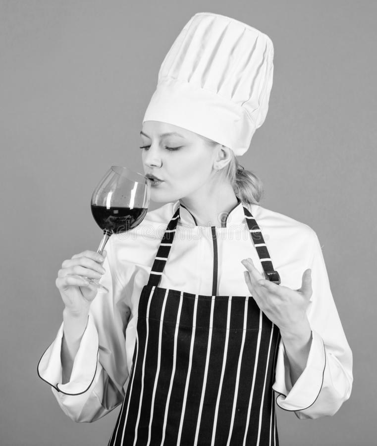 Woman professional chef hold glass of wine. Restaurant concept. Wine degustation. Which wine to serve with dinner. How. To pair wine and food like expert. Girl royalty free stock images
