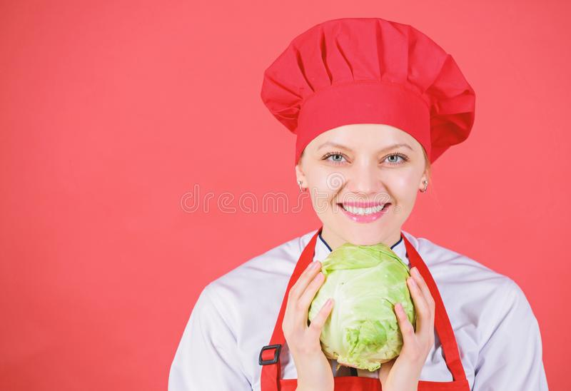 Woman professional chef hold whole cabbage vegetable. Healthy vegetarian recipe ingredient. Eat healthy. Healthy raw royalty free stock photo