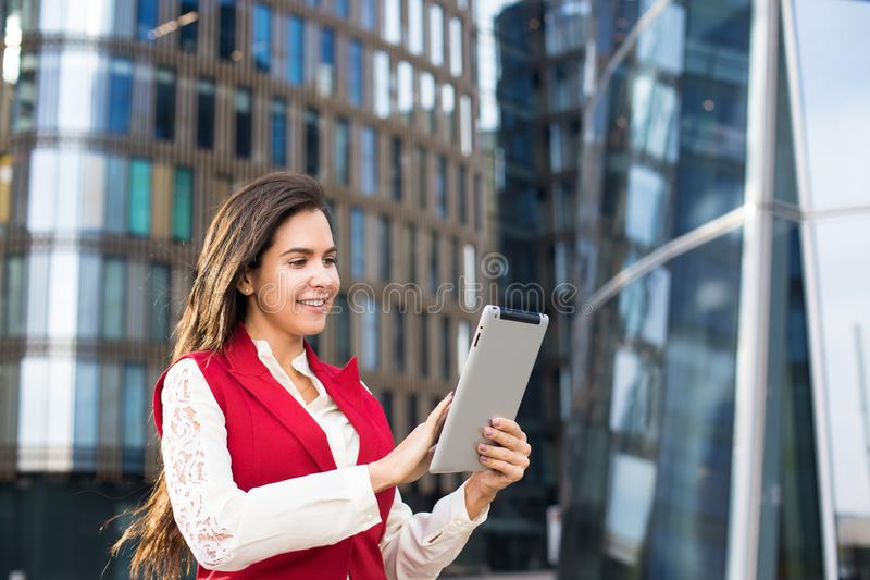Female bookkeeper checking notifications on digital tablet stock images