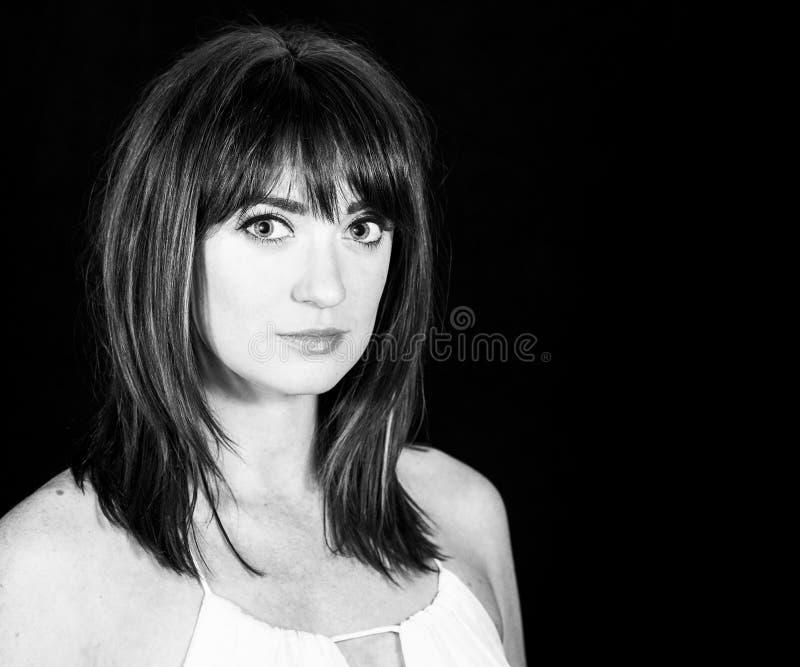 Woman with Professional Hair and Makeup Studio Shoot. Beautiful Woman with Professional Hair and Makeup Studio Shoot royalty free stock photography