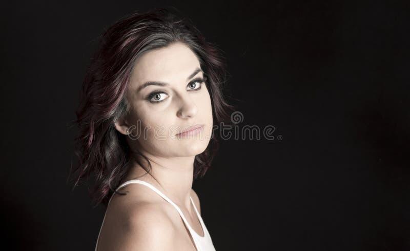 Woman with Professional Hair and Makeup Studio Shoot. Beautiful Woman with Professional Hair and Makeup Studio Shoot royalty free stock image