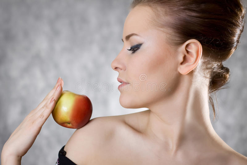 Download Woman profile apple fine stock image. Image of holding - 13194801