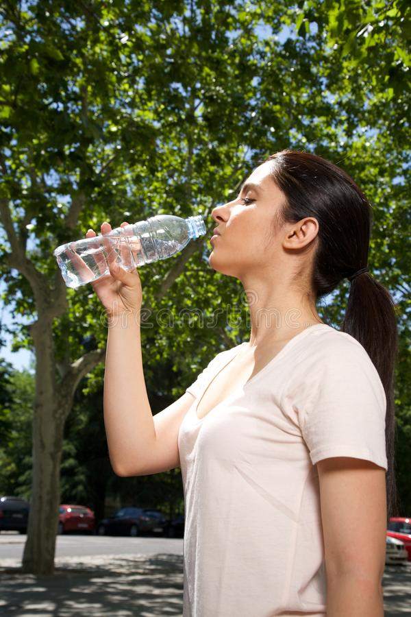 Woman profile drinking water royalty free stock images