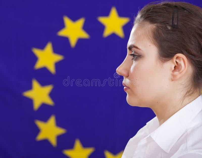 Woman profile portrait over european flag