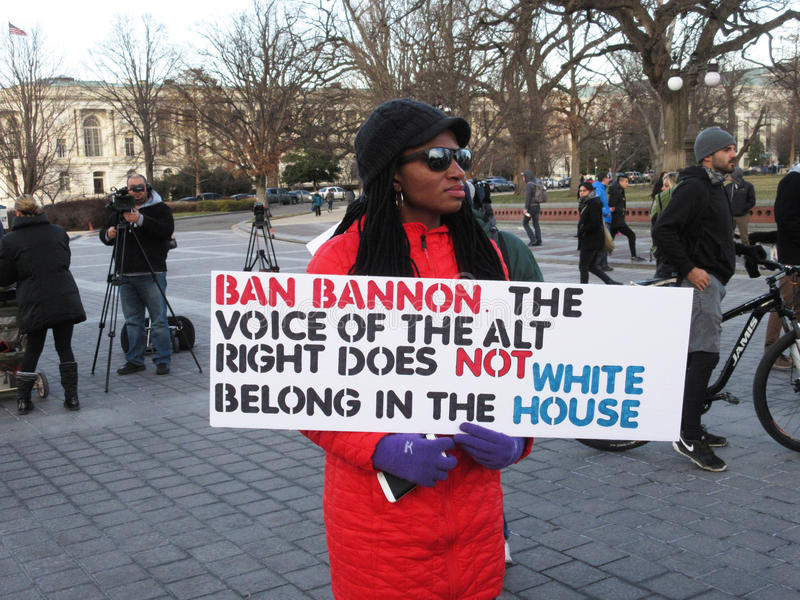 Woman Protesting Against Stephen Bannon stock images