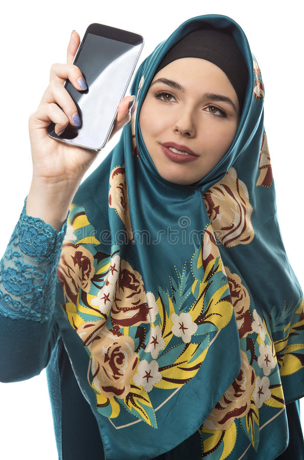 Woman Proudly Showing off Hijab via Selfie. Middle Eastern or East European female proudly showing her conservative fashion via social networking by taking a royalty free stock photography