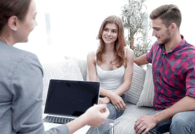 Woman psychologist conducts a session with a young couple. Photo scopy space royalty free stock image