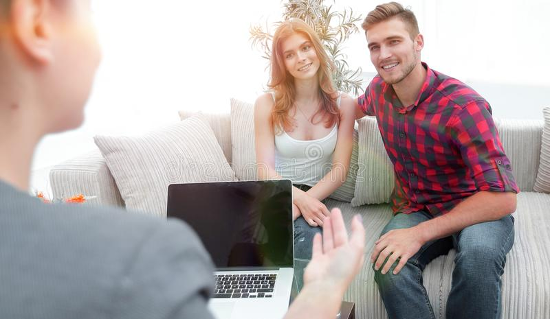 Woman psychologist conducts a session with a young couple. Photo scopy space royalty free stock photo