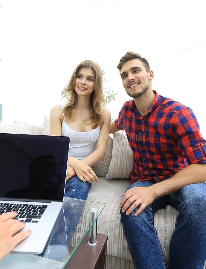 Woman psychologist conducts a session with a young couple. Photo scopy space royalty free stock images