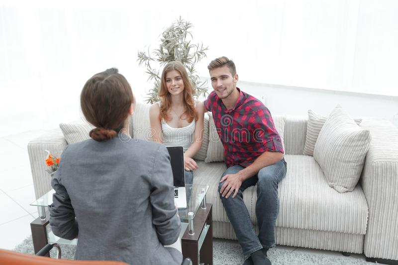 Woman psychologist conducts a session with a young couple. Photo scopy space stock photos