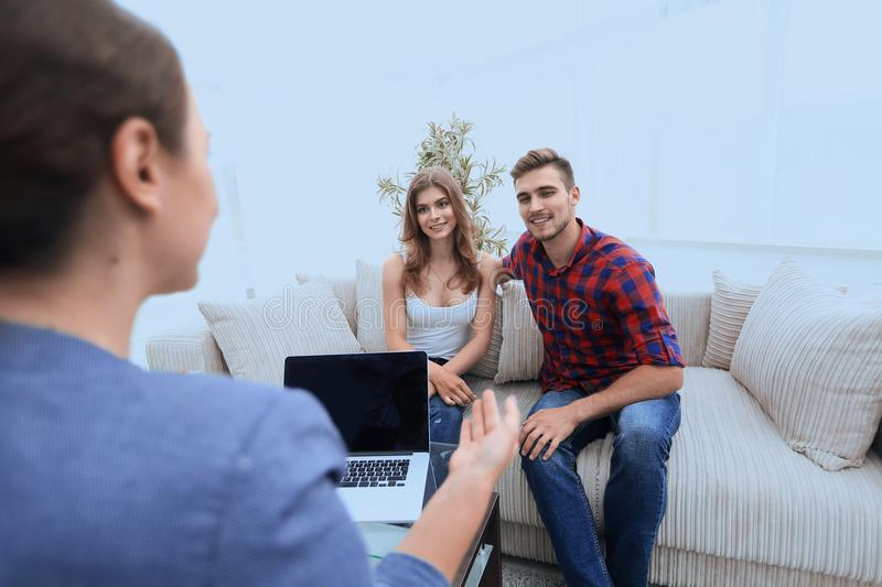 Woman psychologist conducts a session with a young couple. Photo scopy space stock image