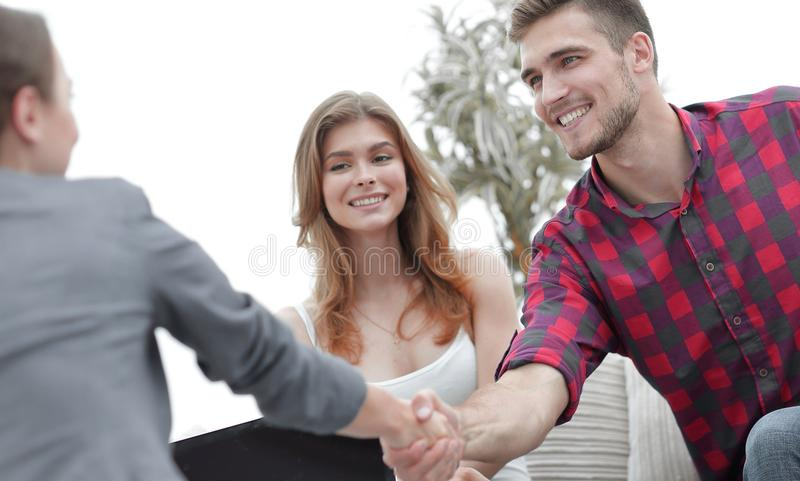 Woman psychologist greets the customer before the beginning of the family session. Photo with copy space royalty free stock photos