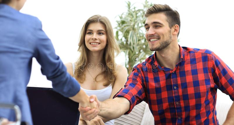 Woman psychologist greets the customer before the beginning of the family session. Photo with copy space royalty free stock photo