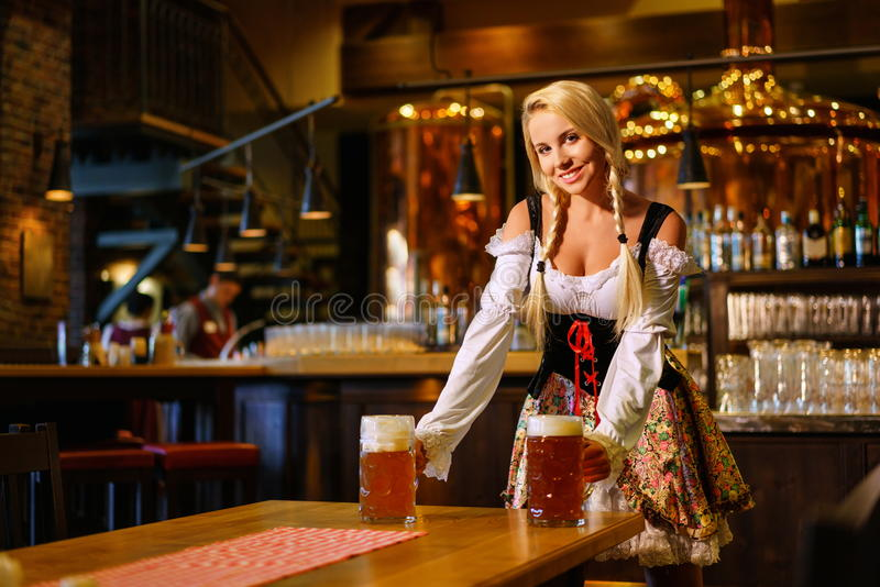 Woman in a pub stock images