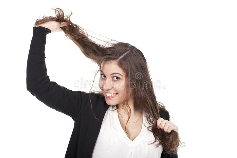 Woman pulling hair royalty free stock images