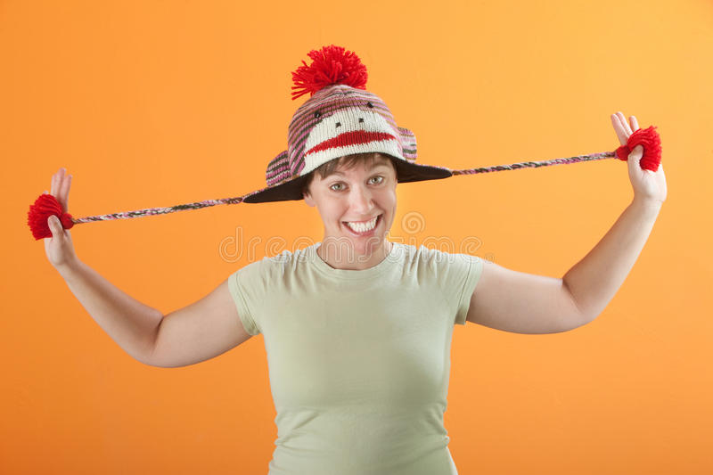 Woman Pulling Her Hat royalty free stock photo