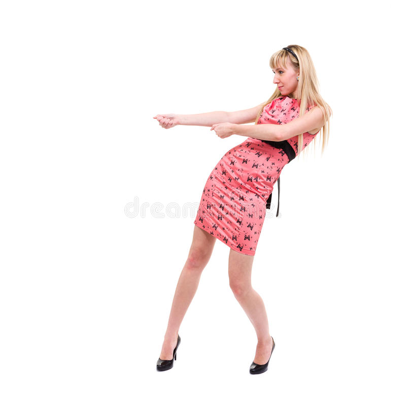 Woman pulling an imaginary rope stock images