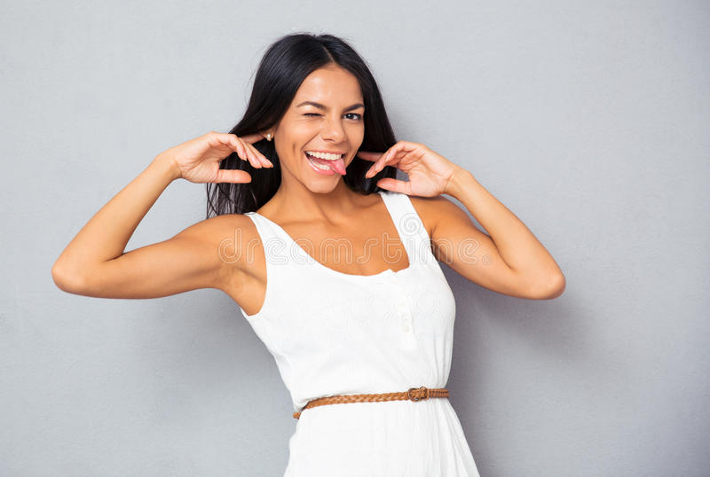 Woman pulling tongue out royalty free stock images