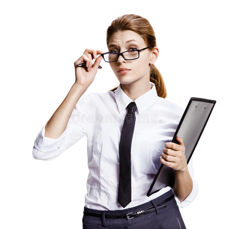 Woman pulls down her eyeglasses. Portrait of young attractive brunette woman looking through half-mast eyeglasses - isolated on white background stock photo
