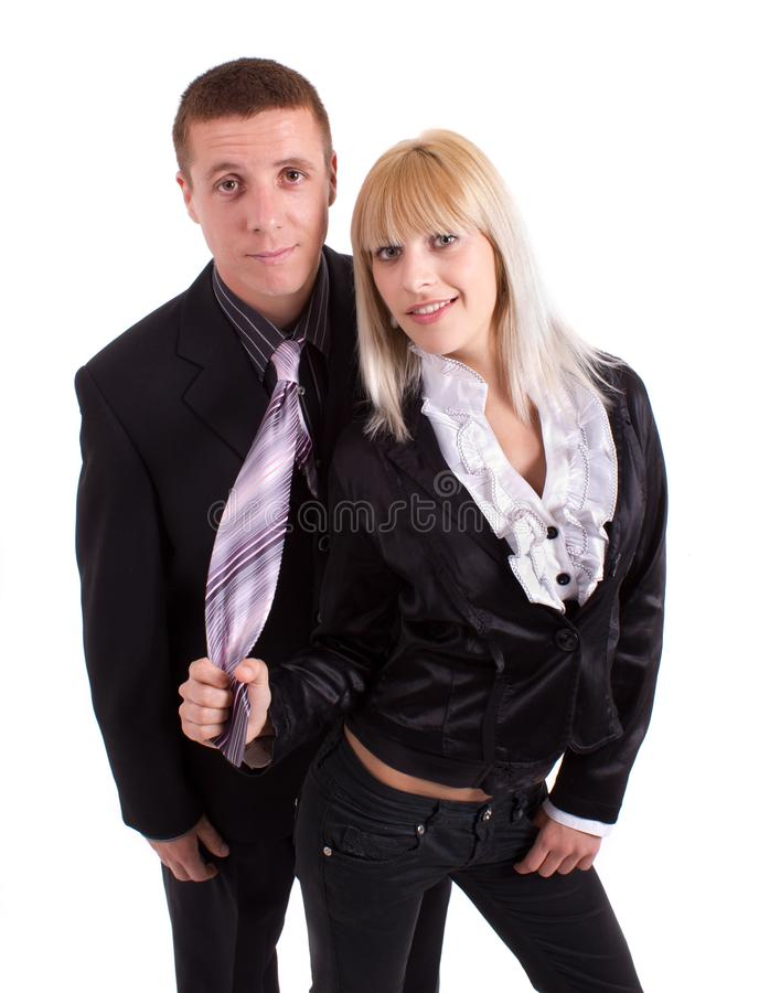 Woman pulls the man tie stock photos