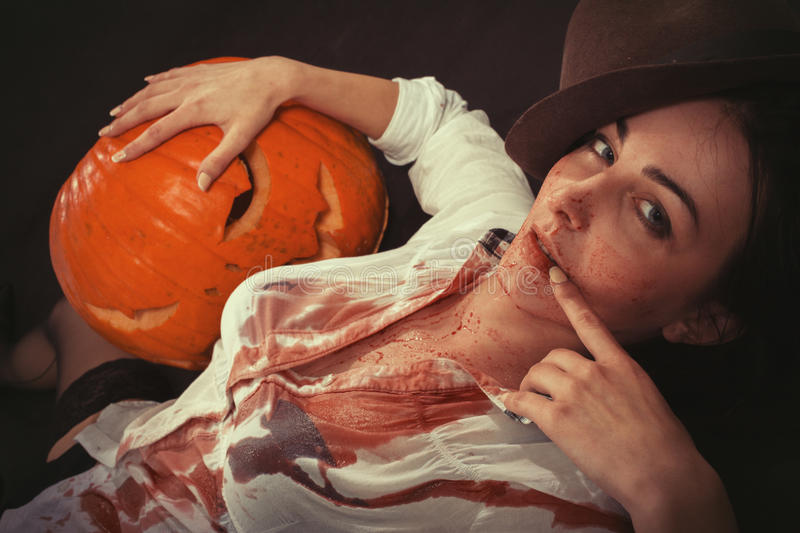 Woman with pumpkin royalty free stock photo