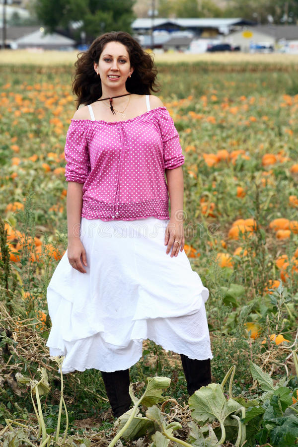 Download Woman in the Pumpkin Patch stock image. Image of photograph - 21853063