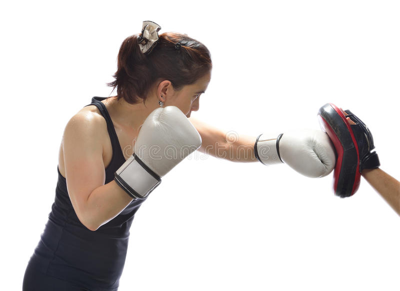Woman punching boxing pad royalty free stock images
