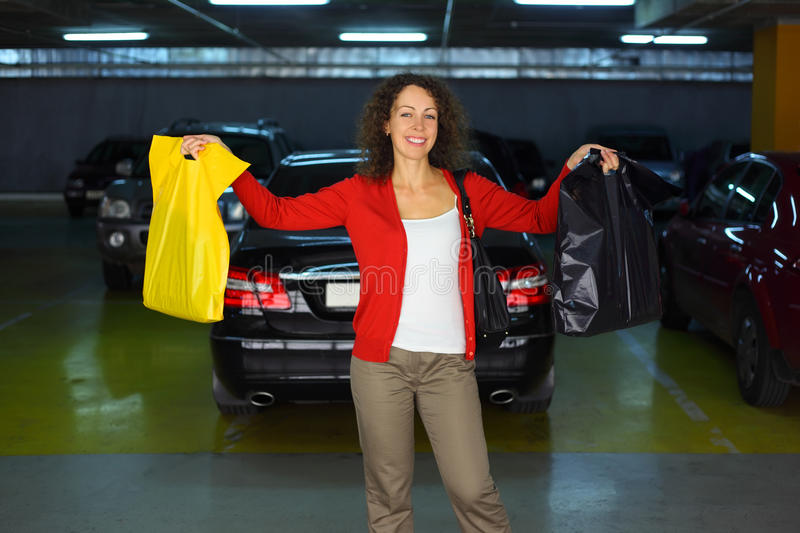 Woman with purchases standing in car parking royalty free stock photos