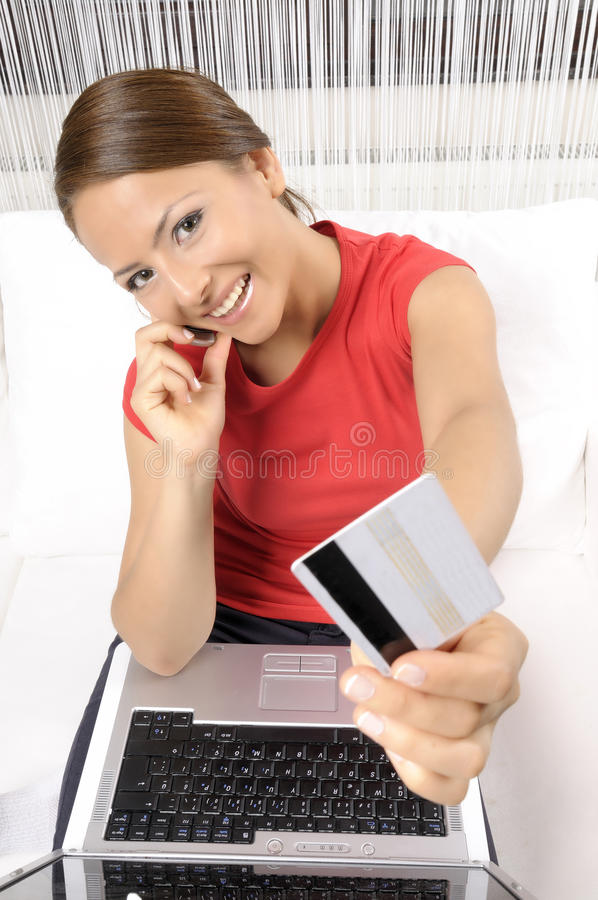 Download Woman Purchasing Product Using Her Laptop Computer Stock Photo - Image: 21367244