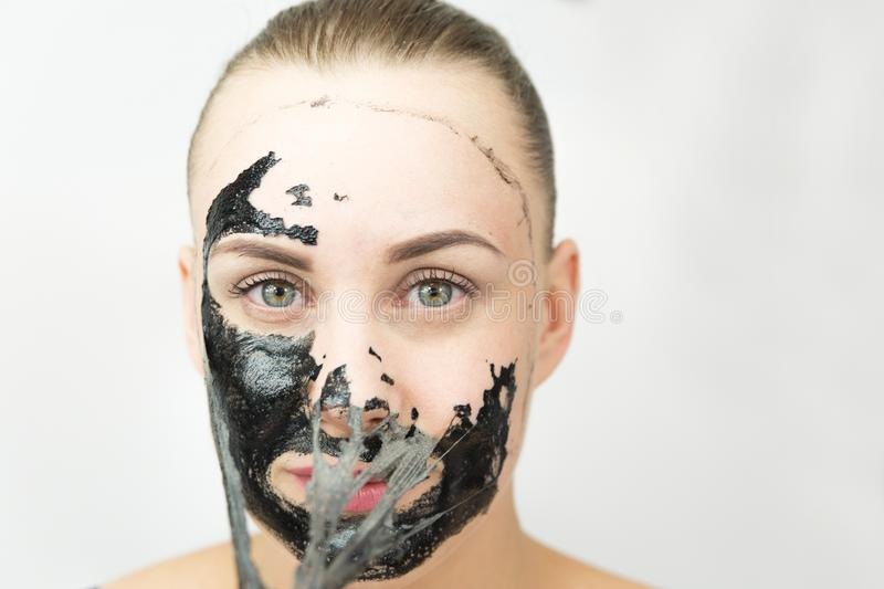 Black mask. Woman with purifying black mask on her face royalty free stock images