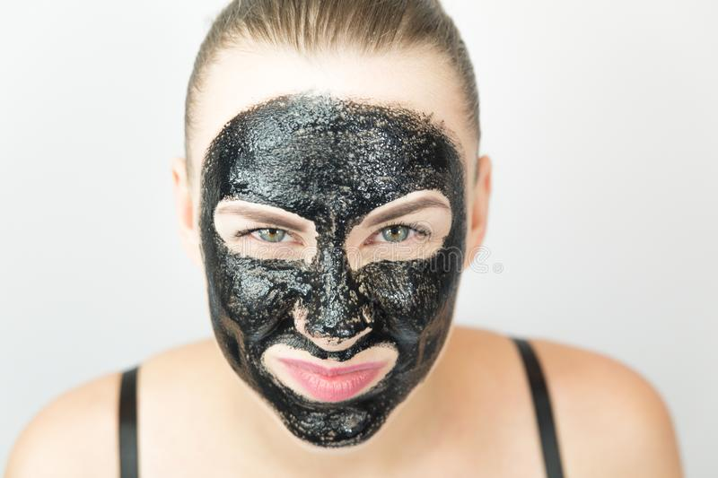 Black mask. Woman with purifying black mask on her face royalty free stock photos