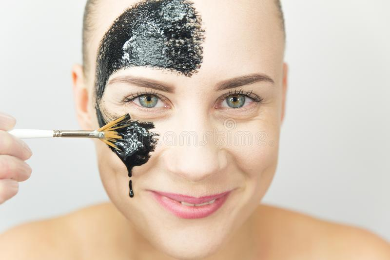Black mask. Woman with purifying black mask on her face stock images