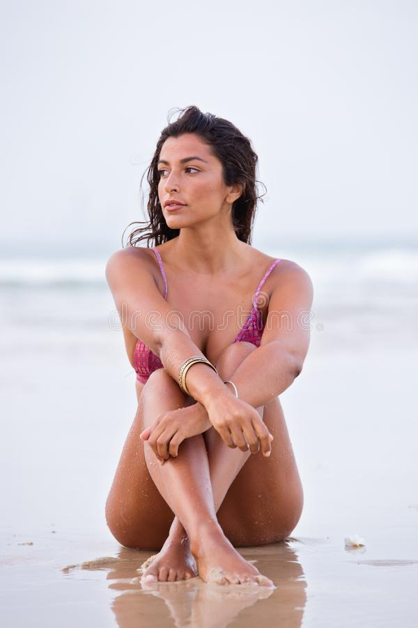 Woman in Purple Bikini Sitting on Shore royalty free stock images