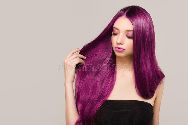 Woman with purple bright hair color. Shades of pink. Straight shiny hair. Woman with purple bright hair color. Shades of pink stock photography