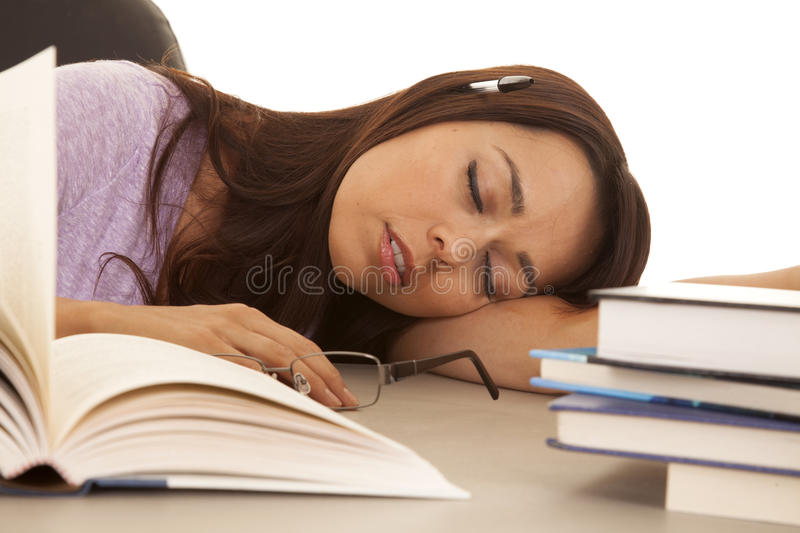 Download Woman Purple Shirt Asleep Pen In Ear Books Stock Photo - Image: 32687026
