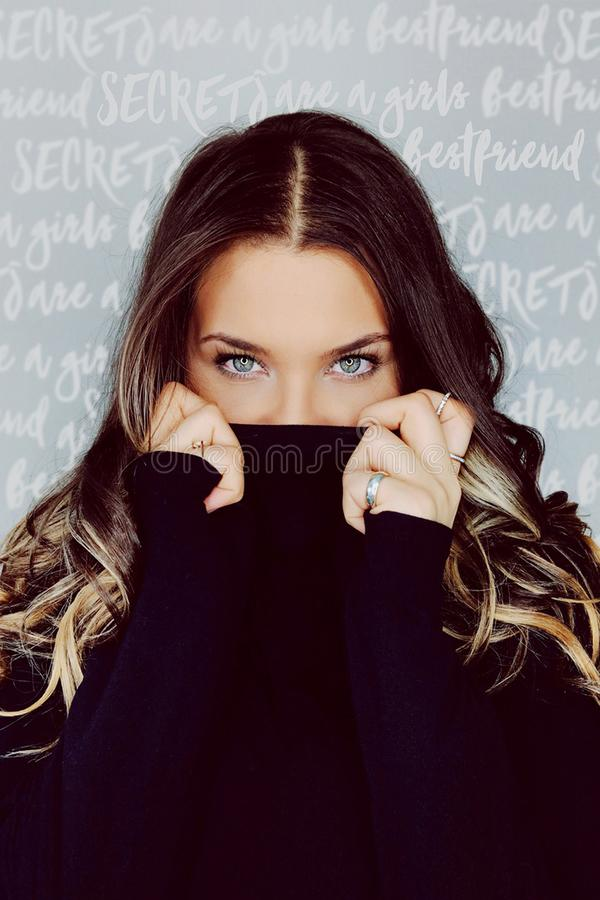 Woman in Purple Sweater Covering Her Face stock images